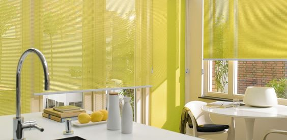 Awesome yellow kitchen with yellow shades. Why not?