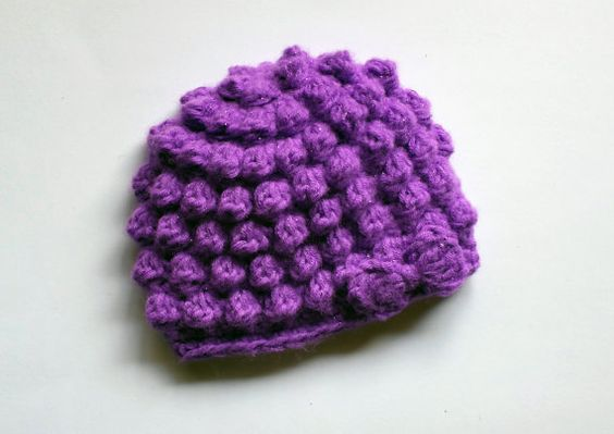 Hey, I found this really awesome Etsy listing at https://www.etsy.com/listing/176974948/purple-bobble-crochet-baby-hat