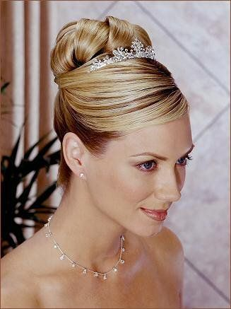 An updo that will work with my Vietnamese head piece as well as for the Western ceremony