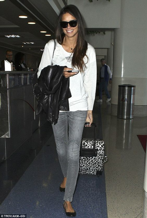 No bikini needed: Victoria's Secret model Adriana Lima looked casual but stunning as she made her way through the airport in Los Angeles, California, on Wednesday