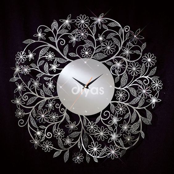 Woodpecker Beautiful Design Wall Clock : Floral chrome wall clock with crystal decoration on