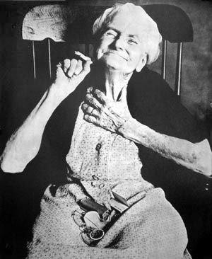 lady in a rocking chair Dmndoityinmo are the letters, 6 letter word required for old lady in rocking chair, runners legs, judges gavel on desk, flashes of light like tyre tracks on a road.