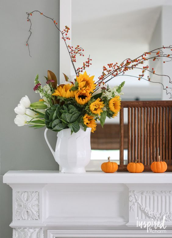 White pitchers ( love the unique selection HomeGoods) are my favorite thing to display flowers. It looks great on a dining room table, in the kitchen, or even on a mantel. Using white lets the flowers be the star of the show! *sponsored pin*
