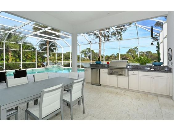 It SOLD - Enclosed outdoor dining area, pool, patio space to the left and a dock just beyond the pool. A great space indeed in University Park, FL - Sarasota - Bradenton area