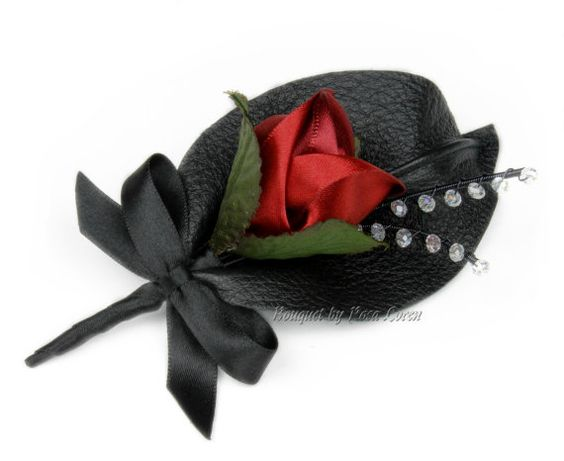 Red satin rose with black leather leaf boutonniere. Rosa Loren Bridal. Find them at: https://www.etsy.com/shop/BouquetByRosaLoren?section_id=12147154