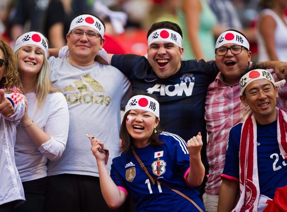 Japanese fans celebrate a glorious win against Switzerland during their first match on June 8, 2015.