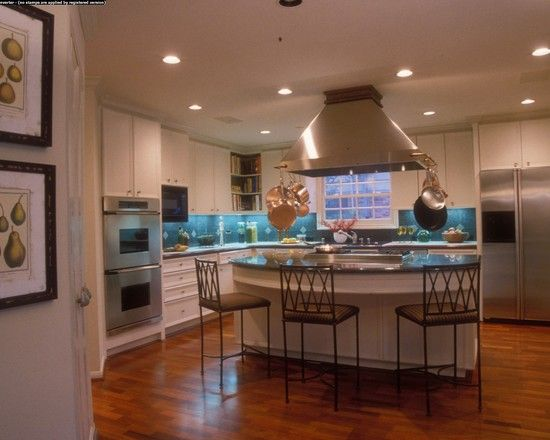When we remodel the kitchen or build another house a must have is an island with the Viking Gas Stove, hood overhead, and wrap around eating area (breakfast bar). I hate having my back to the family while I'm trying to cook if they are already sitting at the table. This opens up for more conversation with family AND friends.