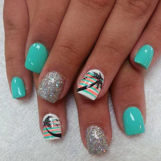 Celebrate the summer with this fun looking nail art design, coated in white, sea green and salmon hues