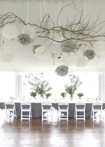 Charm your guests at your dinner party, charity gala or wedding with a tasteful grey and white tissue paper pom arrangement. Photography by Lisa https://www.etsy.com/uk/listing/197944210/14-16-large-poms-white-gray-wedding?ref=market