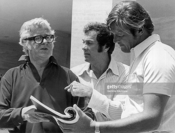 Actors Tony Curtis (center) and Roger Moore (right) on the french riviera during the filming of the television series 'The Persuaders' in 1971.