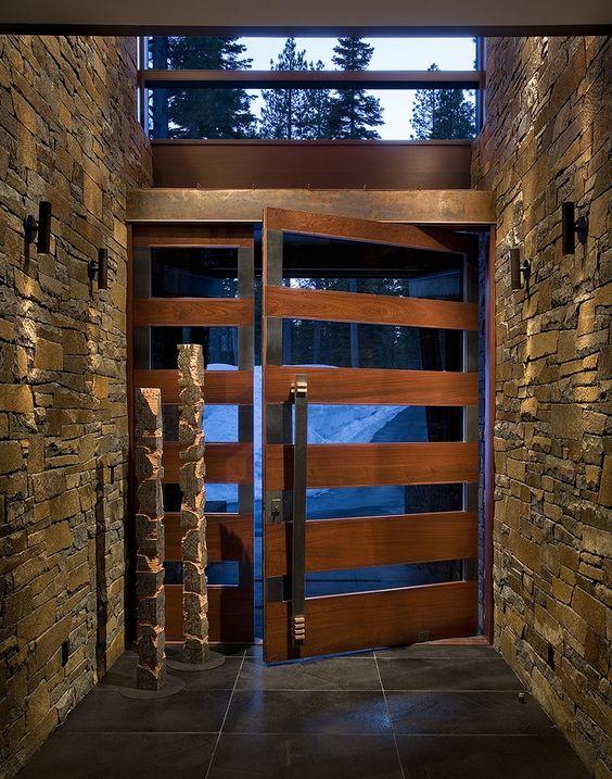 Wood andglass doors the pivot door was made with for Hall entrance door designs