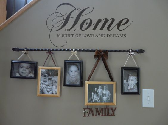 Curtain Rod and some ribbon to hang the pics!! Smart idea