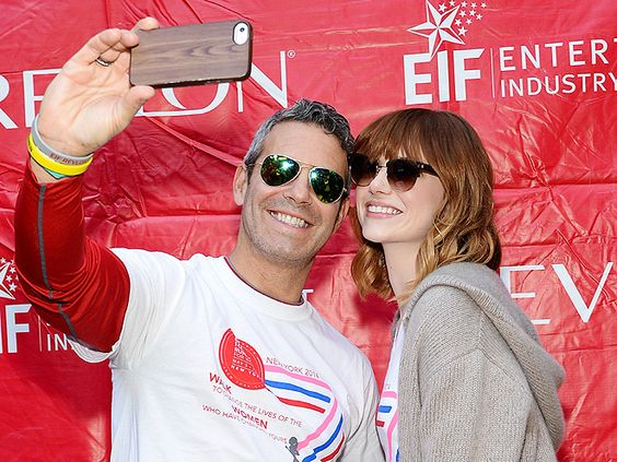 """Andy Cohen and Emma Stone snapped a """"selfie"""" in shady style! Aviators with green flash lenses for him and Clubmasters for her!"""