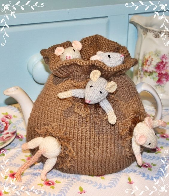 Sack of Mice Tea Cosy, designed by Debi Birkin. Impeccable details make this terrific, like the faux fraying where mice have chewed through the sack.: