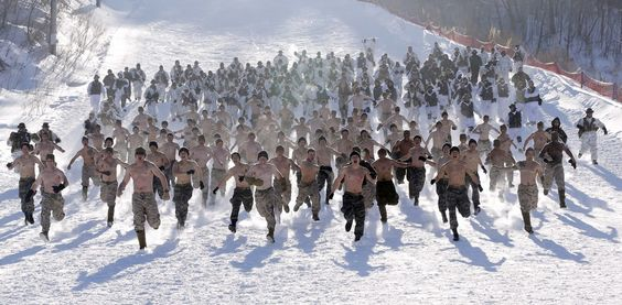Lee Jin-Man / AP    Published at 11:33 a.m. ET: Half-naked South Korean marines and their U.S. counterparts from 3-Marine Expeditionary Force 1st Battalion from Kaneho Bay, Hawaii, run on a snow field in Pyeongchang, South Korea, on Thursday, Feb. 7, 2013.    More than 400 Marines from the two countries participated in the joint winter exercise held for the first time in South Korea.