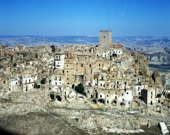 Italian ghost town Craco, Italy.  Earthquakes, landslides, and a lack of fertile farming land have contributed to its abandonment.: