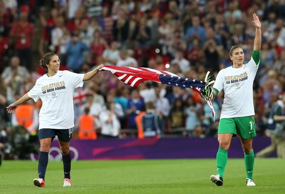 Carli Lloyd and Hope Solo. The US Women's National Soccer team celebrates its win over Japan in the Olympic gold medal final. (GETTY/Ronald Martinez)