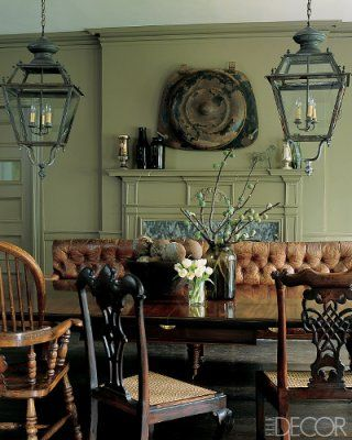 Nineteenth-century French street lanterns above the dining room table in designers Keith Johnson and Glen Senk's home, featured in Elle Decor