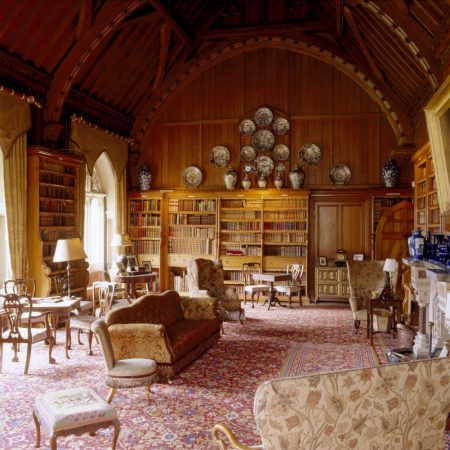 The library at Tyntesfield, a Victorian Gothic Revival estate in Somerset, England. The library contains one of the largest collections of Victorian books in England.: