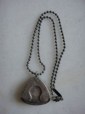 Margiela guitar pick holder necklace....