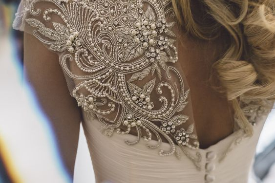 Embellished back 'Cherish' gown by Suzanne Neville | Luxury Coastal Wedding At Oldwalls | White on White Colour Scheme Images by Marc Smith Photography | http://www.rockmywedding.co.uk/tassy-chris/