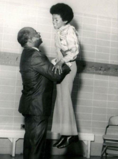 Little Michael Jackson with his grandfather, who also had vitiligo.