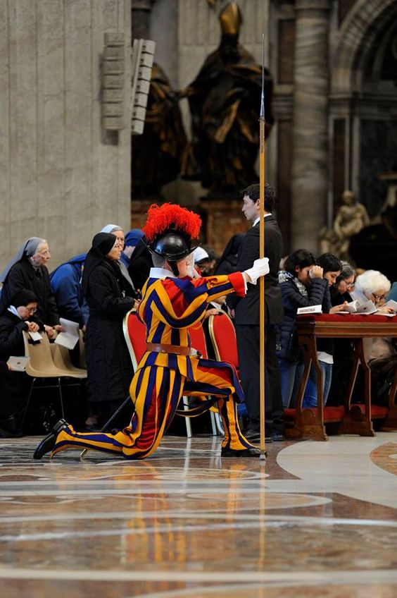 Swiss Guard kneels during Mass inside St. Peter's Basilica