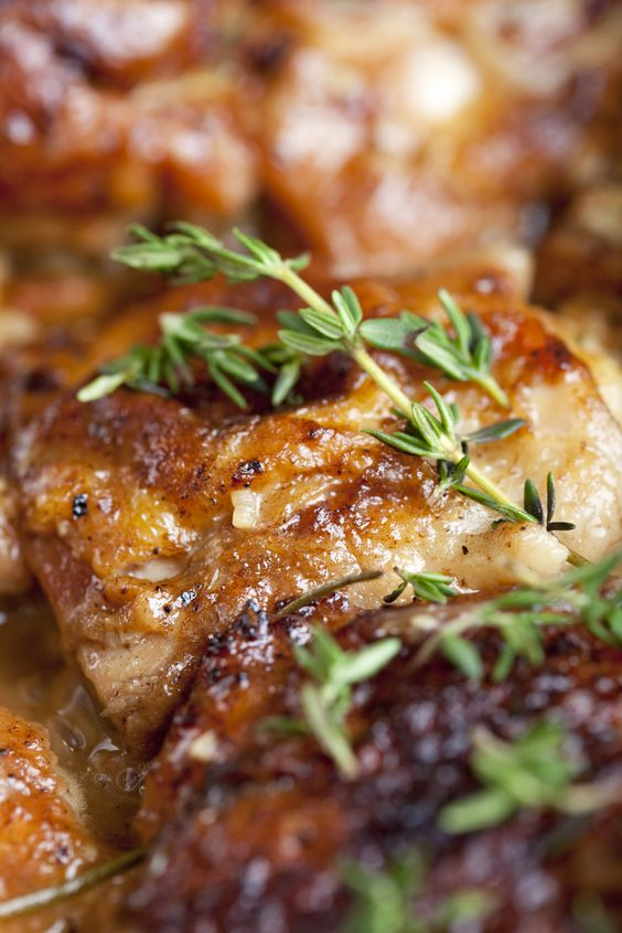 These Braised Chicken Thighs can be made in advance and are perfect for weeknight dinners. Serve with pasta, rice or a loaf of crusty bread. | emerils #Chicken