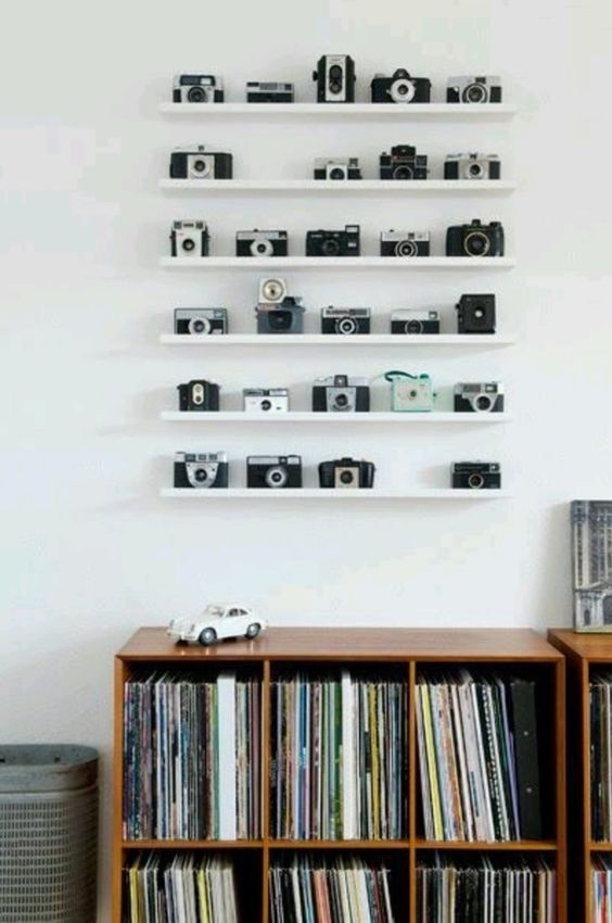 Lining up collectibles along a set of shallow shelves lets them serve as wall art.
