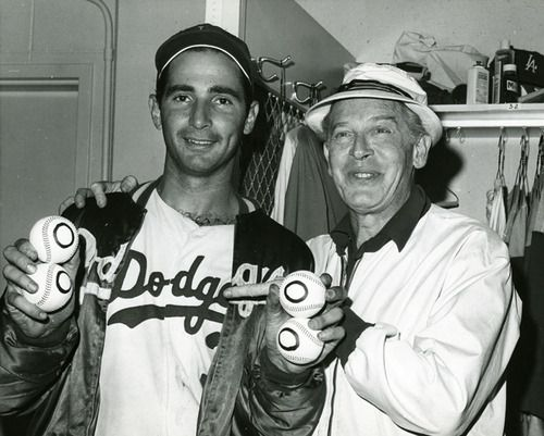 Following His Perfect Game Victory Sandy Koufax Poses With Milton Berle In The Dodgers Clubhouse September 9 Sandy Koufax Nationals Baseball Baseball Star