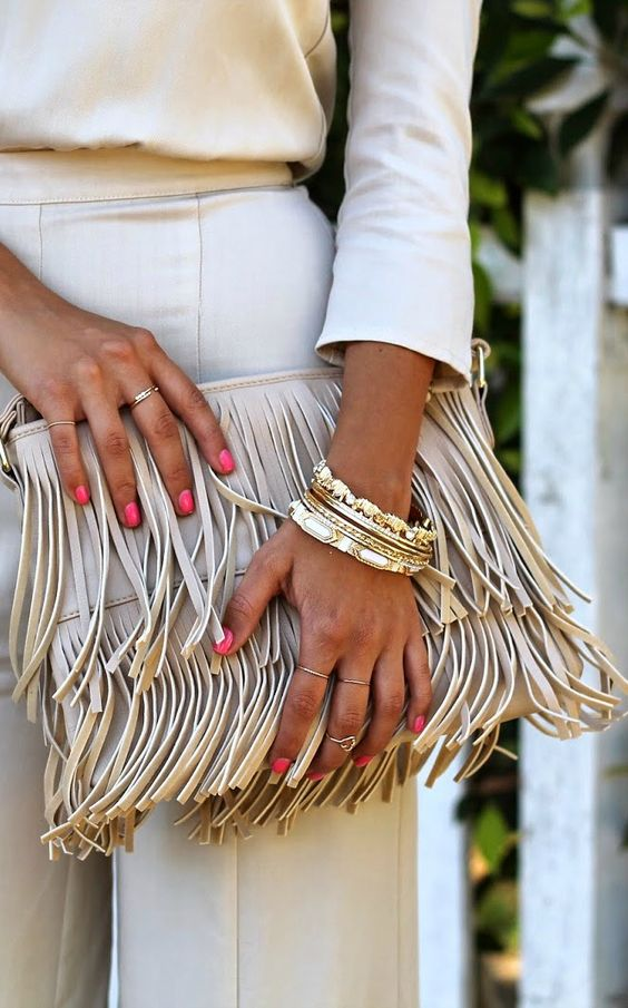 fringe bag and gold accessories: