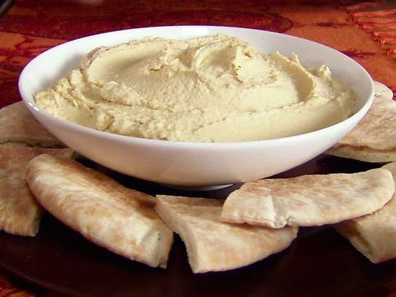Hummus and pita bread or carrots or pretzels