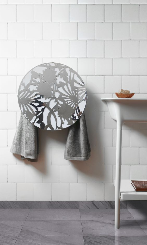 Electric round towel warmer 220V Consumption: 90 watt Thermal efficiency: 78 kcal Towel warmer with a shiny stainless steel laser-cut cover