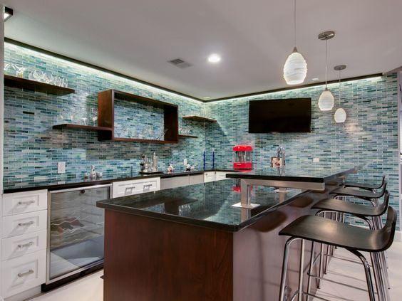 The basement kitchen / bar has been totally revamped by removing ...