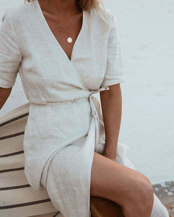 Love this simple white linen wrap dress.