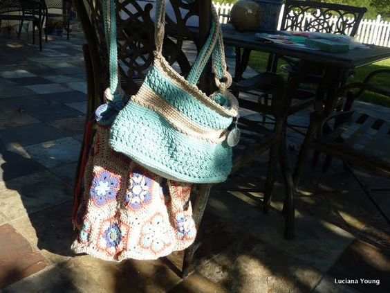 2 Crochet Bags. Gifts from friend! African Flower Hexagon bag in bottom. Top bag is her own beautiful stitch! #crochet #bag