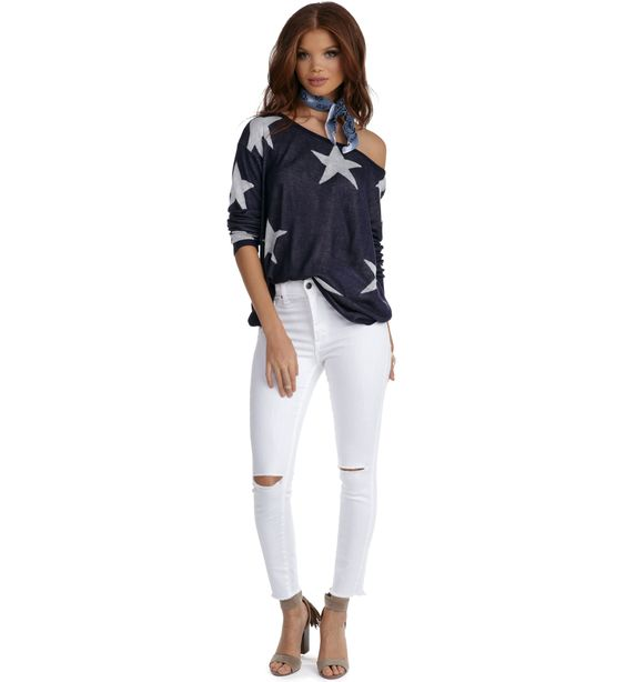 """Shine bright in this adorable star detailed pullover! It features a wide neckline that can be worn off the shoulder, long sleeves and soft knit fabric that offers a relaxed look.PulloverRelaxed fitApprox. 19.5""""(Side seam is measured from under the arm to the hem of the garment.)100% AcrylicHand wash cold. Do not bleach.Model info Model is 5'8with a 30.5"""" bust, 22.5"""" waist and 34"""" hips. She is wearing a size small."""