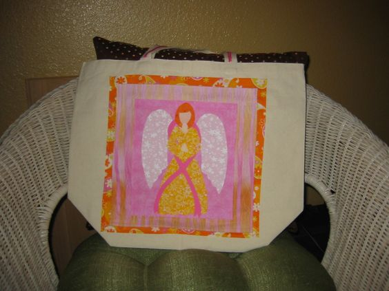 Added fabric to make pockets on the outside of a canvas bag and an appliqué for a friend that survived Breast Cancer and collects angels.