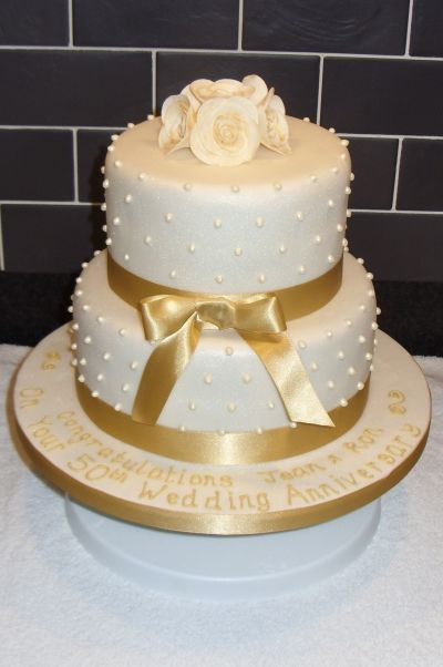 Golden Wedding Anniversary Cake By Kimsi on CakeCentral.com - For all your Golden Anniversary cake decorating supplies, please visit http://www.craftcompany.co.uk/occasions/anniversary/golden-wedding-anniversary.html