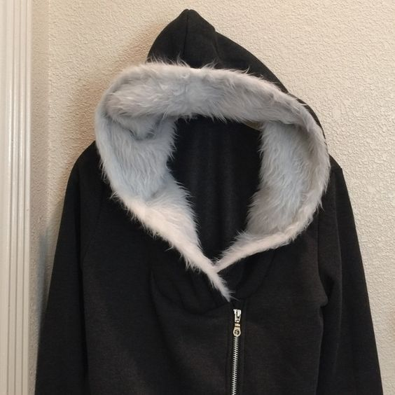 Gray hoodie with synthetic fur Gray hoodie with synthetic white fur in the hood, hugs at the hips, v neck, fits more like a small although tag is medium Finejo Sweaters Crew & Scoop Necks