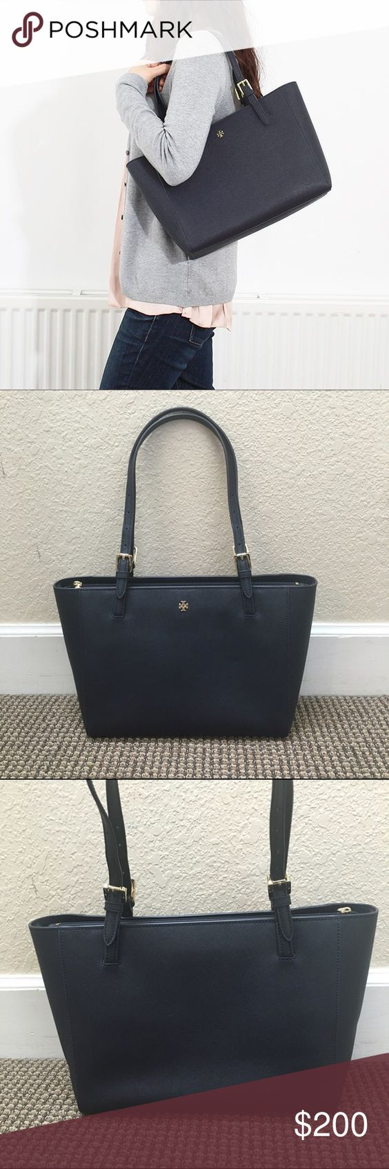 Tory burch York navy saffiano leather tote bag Tory burch shoulder tote. Style is called York and this is the small size. Navy saffiano leather, multiple interior pockets with key clasp, and gold hardware. Holds a 13 inch laptop! Excellent condition Tory Burch Bags Totes