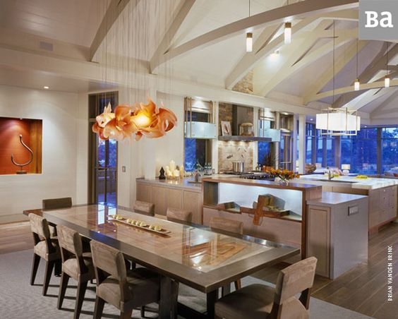 From Breese Architects portfolio. I love that chandelier. The clean lines and warmly lit space look so inviting. A perfect place for a summer feast and cocktails.