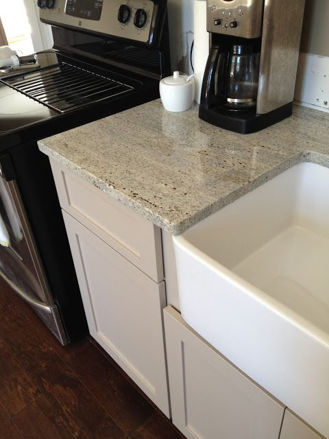 Grey cupboards can be a little more subdued and blend well with the white granite countertops.