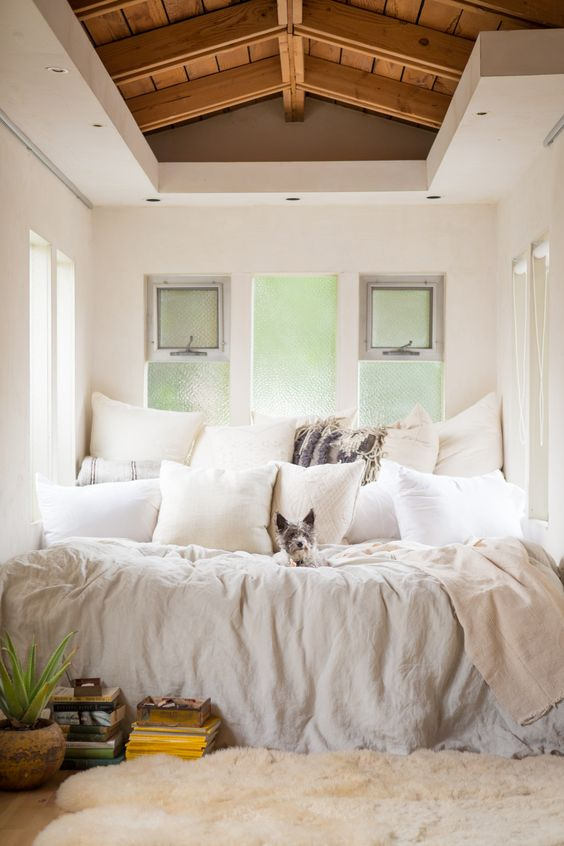 Bohemian luxury bedroom with white linens and a ton of pillows! #LeanneFord Venice House of Leanne Ford shot by Douglas Lyle Thompso.