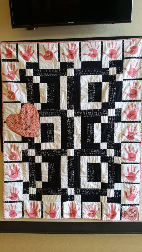 Kindergarten: Hearts and Hands to God Quilt: This beautiful handmade quilt includes the handprints of each student with their names and bible verse which are patched perfectly in red, white and black. What a great way to remember your little ones first year of school.
