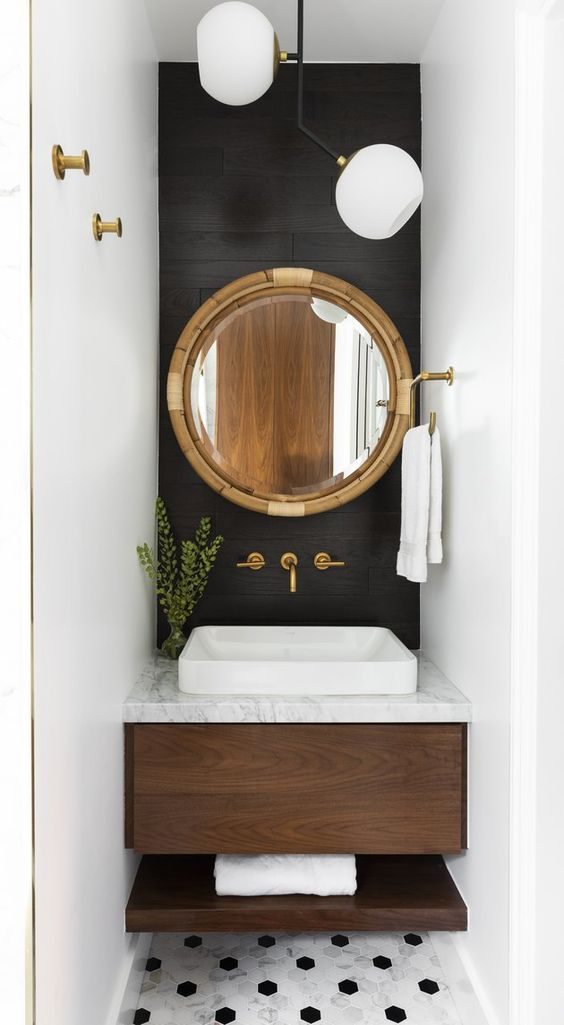 """""""Powder baths are the perfect place to play with saturated hues because they are secondary spaces enjoyed by family and guests, but aren't relied on for getting ready every morning,"""" Marie Flanigan says. """"If you're a fan of dark paint, but still want your space to be bright, consider painting an accent wall with your bold color while keeping the rest of your walls light."""""""
