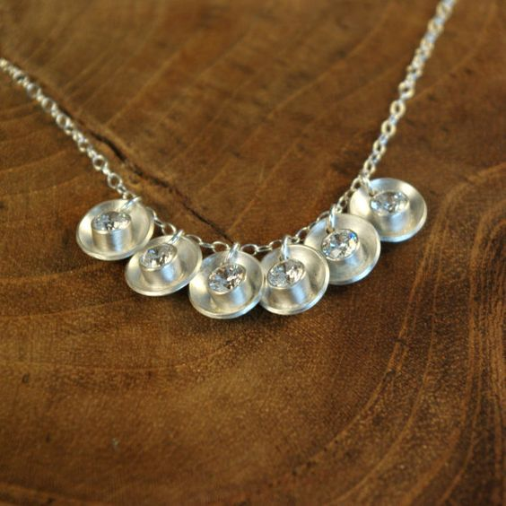 cute! Tube-set crystals in dapped and domed sterling silver.