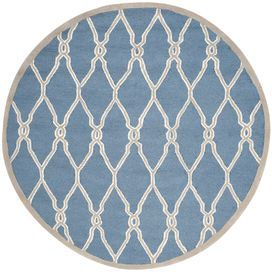 "Add a pop of pattern to your living room or den with this hand-tufted wool rug, showcasing a trellis motif in navy.  Product: RugConstruction Material: 100% WoolColor: Navy and ivoryFeatures: Hand-tufted Pile Height: 0.63"" Note: Please be aware that actual colors may vary from those shown on your screen. Accent rugs may also not show the entire pattern that the corresponding area rugs have.Cleaning and Care: Professional cleaning recommended"