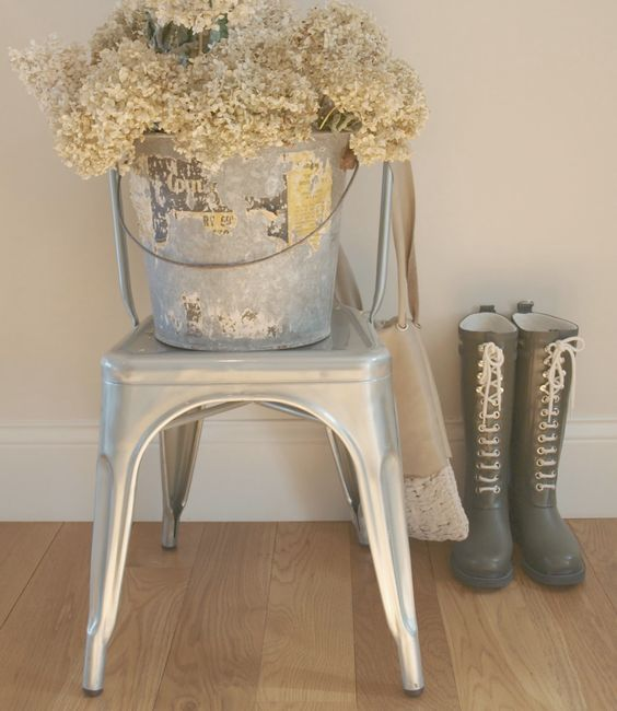Silver French Tolix chair with vintage galvanized bucket of dried hydrangea/Ilse Jacobsen boots with laces/white oak hardwood flooring. Come be inspired on Hello Lovely by 7 Low Cost Timeless Decorating Ideas That Don't Involve the Dollar Store As Well As Photos Around My House.