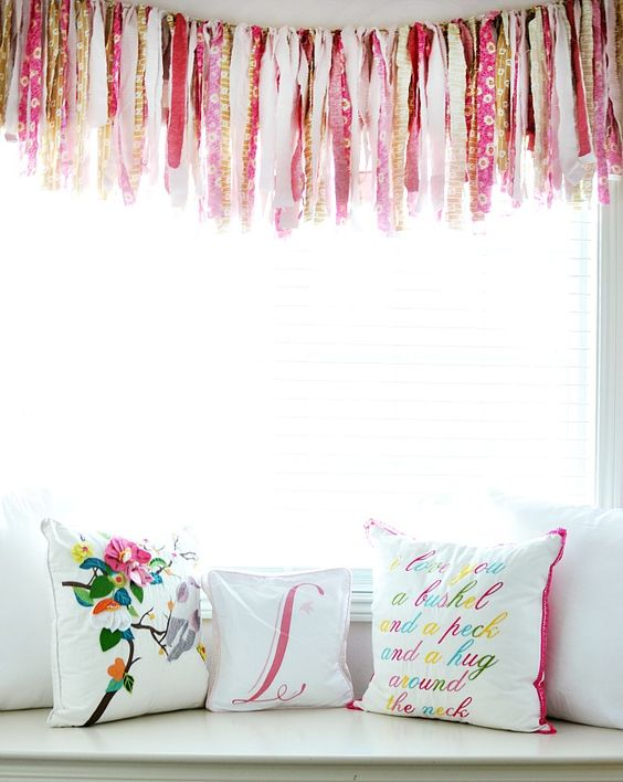What little girl wouldn't love this window seat in her room? The fabric garland is the perfect touch of whimsy.